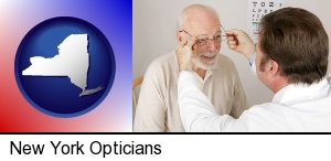 an optician fitting eyeglasses on an elderly patient in New York, NY