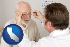 california map icon and an optician fitting eyeglasses on an elderly patient