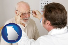 georgia map icon and an optician fitting eyeglasses on an elderly patient