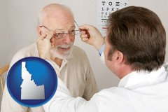 idaho an optician fitting eyeglasses on an elderly patient