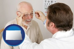 north-dakota an optician fitting eyeglasses on an elderly patient
