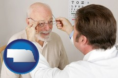 nebraska map icon and an optician fitting eyeglasses on an elderly patient