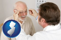 new-jersey map icon and an optician fitting eyeglasses on an elderly patient