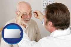 pennsylvania map icon and an optician fitting eyeglasses on an elderly patient