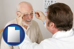 utah map icon and an optician fitting eyeglasses on an elderly patient