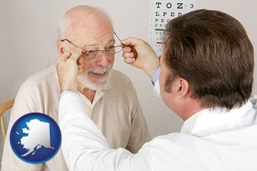 an optician fitting eyeglasses on an elderly patient - with Alaska icon