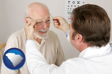 an optician fitting eyeglasses on an elderly patient - with South Carolina icon